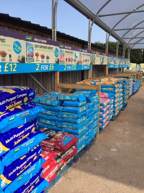 Pallets of compost and aggregate